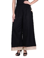 Black Cotton Palazzos With Embroidered Hem - By