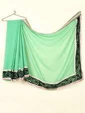 Plain Green Georgette Saree With Lace Border - ABHIRUPA
