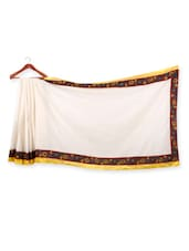 Solid White Saree With Floral Border - URBAN PARI