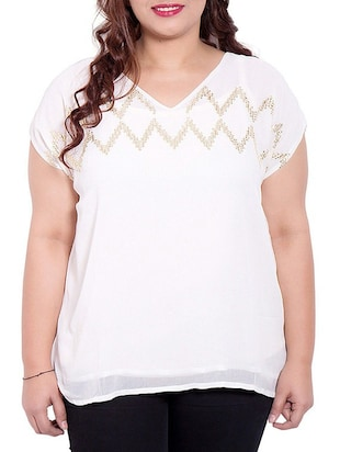 white colored georgette top with embellishment