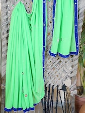 Green Georgette Velvet Border Saree - Lazza