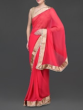 Coral Poly Georgette Saree With Gold Border - Jindal Saree