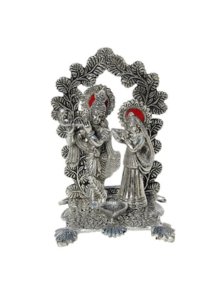 Radha Krishna statue in Metal with arch at back