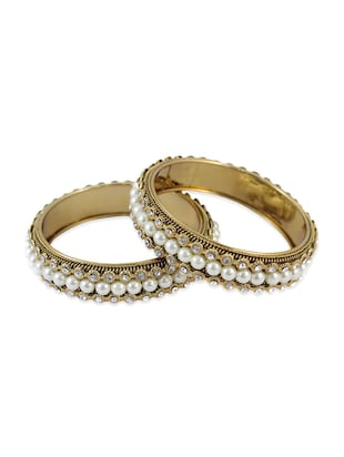 white color, bangles with stone work and pearl embellishment