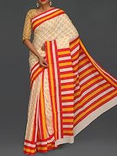 Striped Pallu Yellow Paisley Printed Saree - Komal Sarees