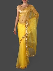 Yellow Net Saree With Sequined Border - Janasya