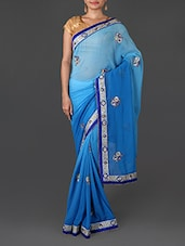 Shaded Blue Georgette Saree With Floral Embroidery - By