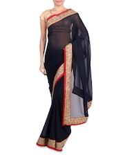 Navy Blue Faux Georgette Saree With Embroidered Border - By