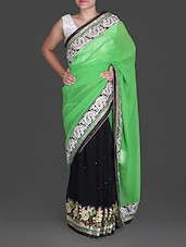 Green And Black Embroidered Georgette Saree - Anubhooti