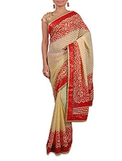 Cream And Red Printed Georgette Saree - By