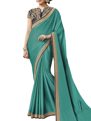 green crepe saree with blouse