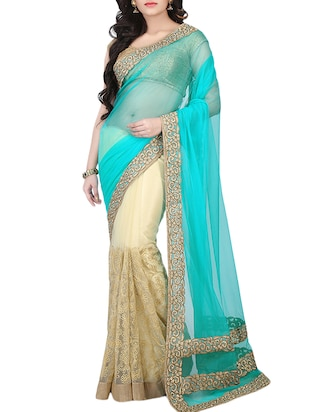 beige and sky blue net saree