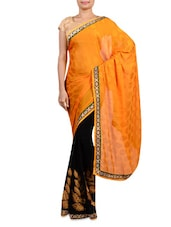 Yellow And Black Georgette Embroidered Saree - By