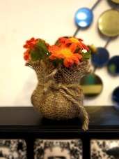 Orange Plastic Sunflowers With Brown Jute Bag - By