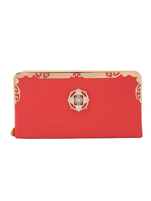 pink synthetic leather clutch