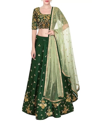 Green raw silk panelled lehenga