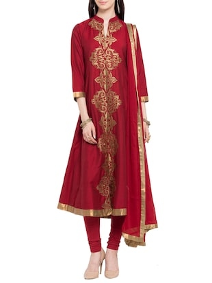 Red stitched flared suit
