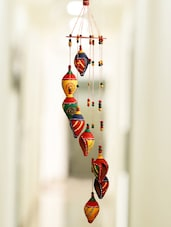 ExclusiveLane 'Shankh Twirls' Hand-Painted Decorative Hanging In Terracotta -  online shopping for Wall Hanging
