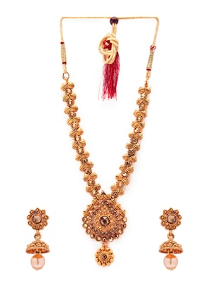gold metal necklaces and earring - 15731227 - Standard Image - 2