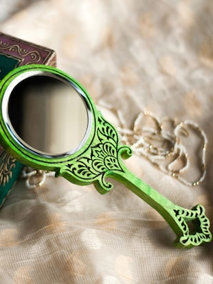 Green oval shaped hand painted wooden mirror