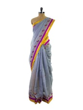 Stunning Silver Super Net Saree With Purple And Yellow Border - Pothys