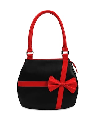 feminine black handbag with red bow and straps