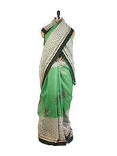 Gorgeous Green And Off-White Super Net Saree With Resham Embroidery, Patch Border And Matching Black Art Silk Blouse. - Drape Ethnic