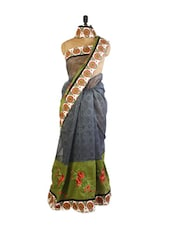 Fashionable Grey And Green Super Net Saree With Resham Embroidery, Patch Border And Matching Green Blouse. - Drape Ethnic