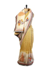 Beautiful Yellow And Off-White  Super Net Saree With Resham Embroidery, Patch Border And Matching Grey Blouse. - Drape Ethnic