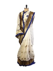 Awesome Off-White Super Net Saree With Resham And Zari Embroidery, Patch Border And Matching Blue Blouse. - Drape Ethnic
