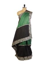 Beautiful Green And Black  Festive Wear Art Silk Saree With Zari Embroidered Border, Stone Work And Patch Border, Black Art Silk - Drape Ethnic