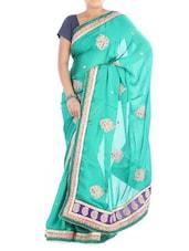 Aqua Satin Saree With Paisley Border - Saraswati