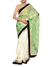 Fantabulous White And Green Half And Half Georgette Saree With Striking Black Border - Tanisi