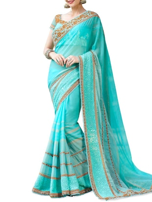 Embroidered and Embellished Sky Blue Georgette Saree