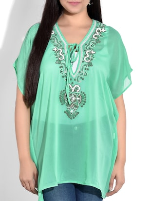 turquoise kaftan with dori closure