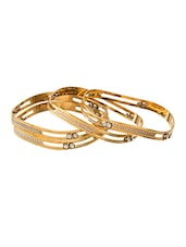 Set Of 4 Gold Plated Bangles Adorned With Shiny CZ Stones - Voylla