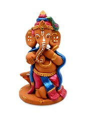 Terracotta Handpainted Ganesha Posing Like Lord Krishna - ExclusiveLane