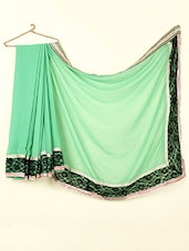 Plain Green Georgette Saree With Lace Border - ABHIRUPA
